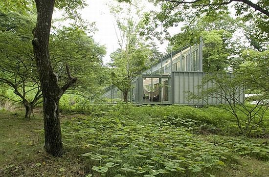 Eco architecture a greenhouse to keep you and your plants warm and so we design - Houses woods nature integrated ...